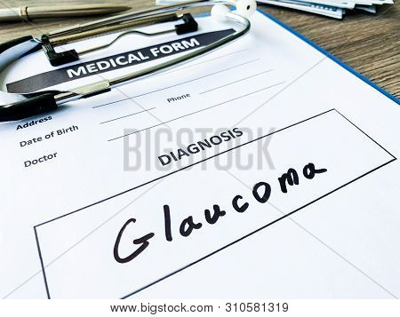 Diagnosis Glaucoma In A Medical Form On The Doctor Desk.