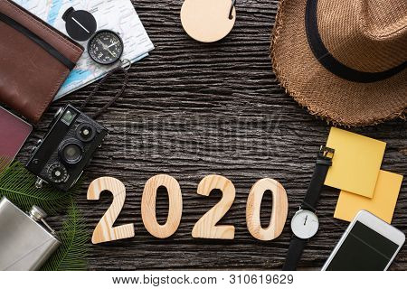Top View 2020 Happy New Year Number On Wood Table With Adventure Accessory Item,holiday Vacation Pla