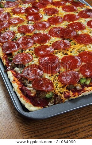 Hot Home-made Pepperoni Pizza with Cheese and Vegetables