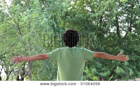 A Young Man Embraces the Beauty of Nature