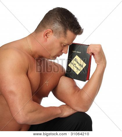 Muscle Man with Bible in Prayer