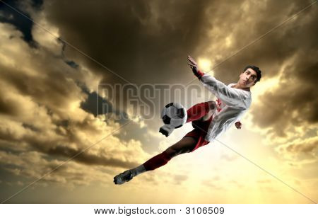 a soccer player in a action and a