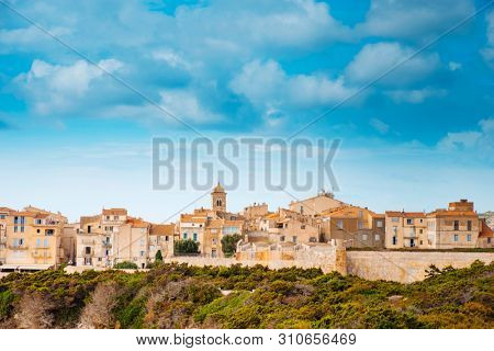 a view of the Haute Ville, the old town of Bonifacio, in Corsica, France, built on the top of a promontory next to a cliff over the Mediterranean sea