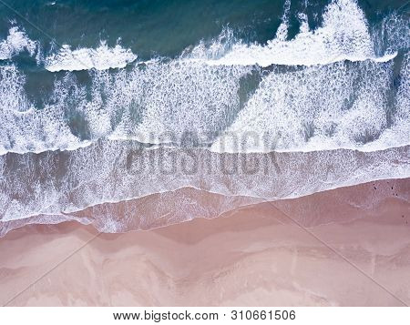 Aerial Overhead Waves And A Beach Coastline