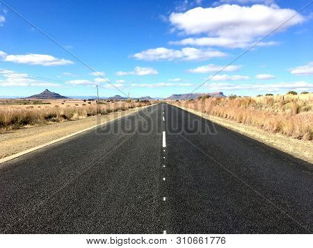 Wide Open Road In The Open Countryside