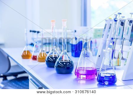 Chemical Analysis, Pharmacology And Laboratory Concept. Flasks With Colored Liquid Reagents In A Sci