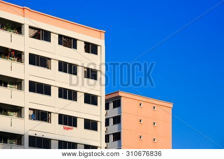 Singapore-22 Feb 2019:singapore Hdb Residential Building In Blue Sky Background View