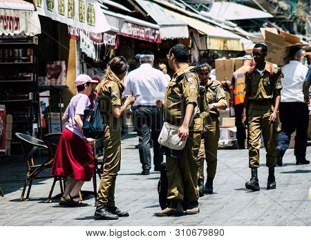 Jerusalem Israel July 3, 2019 View Of Unknown Israeli Soldier Walking And Shopping At The Mahane Yeh