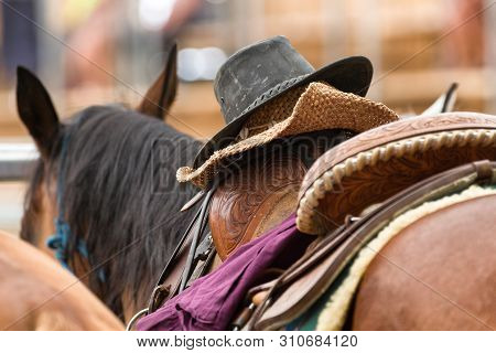 Cowboy Hat At Saddle On Horse In Rodeo
