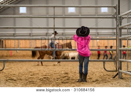Cowboy Kid Watching At Arena On Rodeo Show