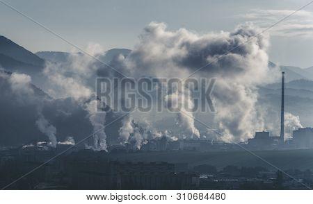 Smoking Chimneys In Factory. Air Pollution. Town Ruzomberok,slovakia