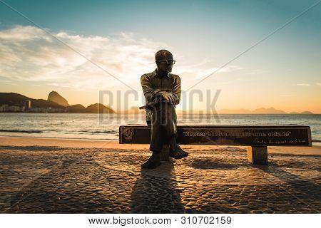 Rio De Janeiro, Brazil - July 1, 2019: Statue Of Brazilian Poet Carlos Drummond De Andrade Sitting O