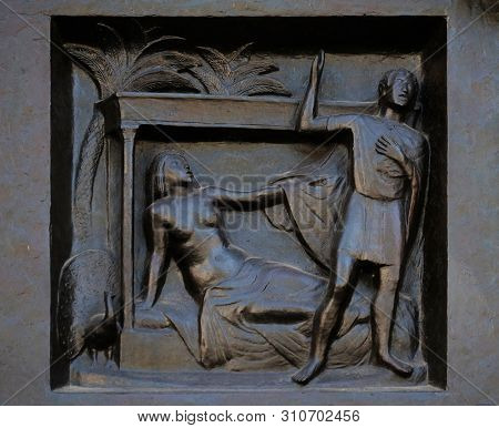 ZURICH, SWITZERLAND - JUNE 23, 2018: Thou shalt not commit adultery - Joseph and Potiphar's wife, relief on the door of the Grossmunster (