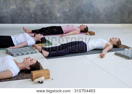 Women Practicing Yoga Lesson, Doing Dead Body, Savasana, Exercise Corpse Pose