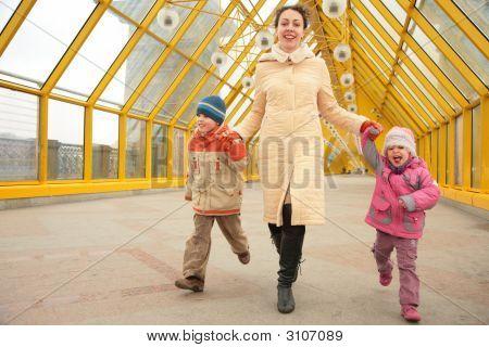 Mother With Children On Footbridge