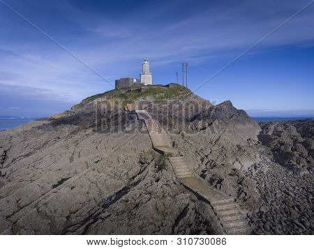 The Steps That Lead To Mumbles Lighthouse And World War Two Battlements In Swansea, South Wales Uk
