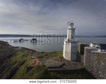 The Iconic Landmark That Is Mumbles Lighthouse On The Gower Peninsula In Swansea, South Wales, Uk.