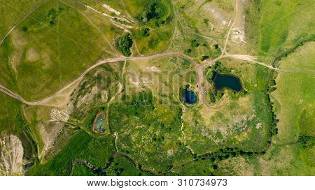 Aerial View From The Drone Of Summer Landscape With River, Hills And Forests.