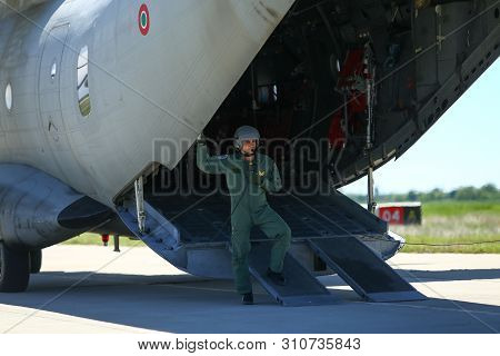 Boboc, Romania - May 22, 2019: A Military Mechanic Is Standing In An Alenia C-27j Spartan Military C