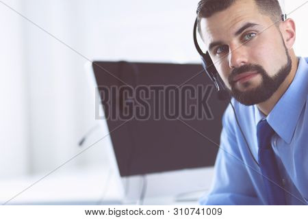 Businessman In The Office On The Phone With Headset, Skype, Facetime