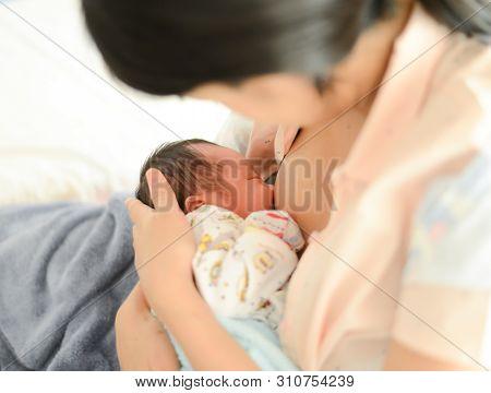 Mother Breastfeeding Her Newborn Baby Boy, Breast Milk.