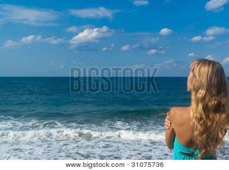 Sexy Woman On A Beach Looking Far On Horizon