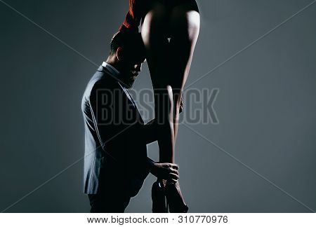 Bearded Man Is Sexy Girl. Long Pretty Woman Legs. Handsome Bearded In Suit. Woman Dominates The Man,