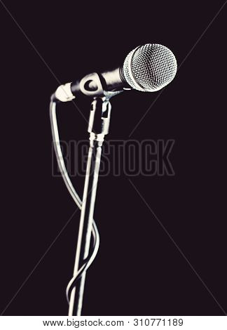 Microphone, Mic, Karaoke, Concert, Voice Music. Closeup Microphone. Vocal Audio Mic On A Bleck Backg