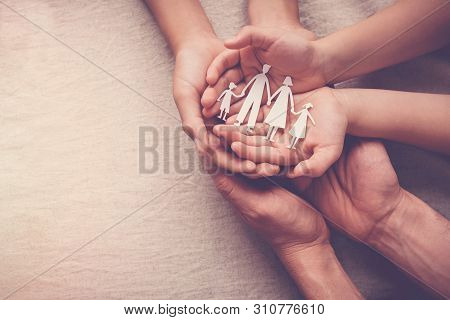 Adult And Children Hands Holding Paper Family Cutout, Family Home, Foster Care, Homeless Support Con