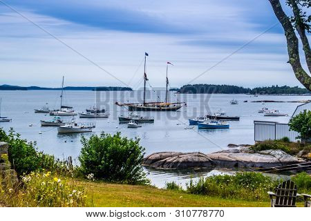Acadia National Park, Me, Usa - August 12, 2018: A Sailing Yacht Boat Stationed Along The Shore Of A