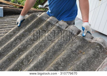 Asbestos Removal Roofer Roof Works. House With Old, Danger Asbestos Roof Tiles Repair And Renovation