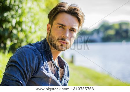One Handsome Young Man By River In City