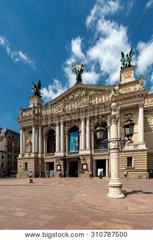 Lviv, Lviv Oblast, Ukraine - 2018/07/07: Tourists Outside The Lviv Theatre Of Opera And Ballet In Lv