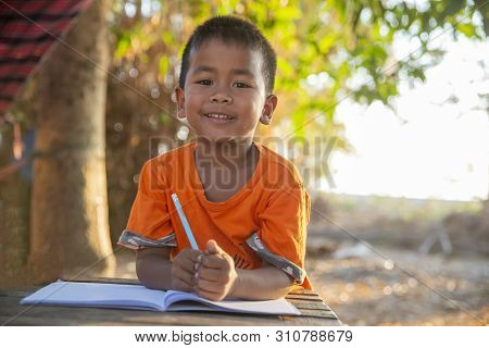 Asian Child (poor Kids) Study At Old Home.asia Boy Learning To Drawing,painting With Color Pencil. P