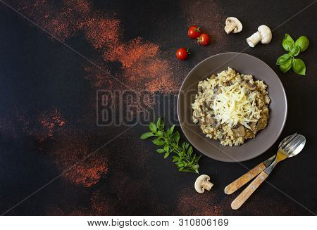 Traditional Italian Dish Of Rice Arborio Risotto With Mushrooms. Served With Fresh Basil, Mushrooms