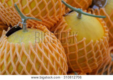 Muskmelon Fruit (cantaloupe) With Foam Net In Fruit Market