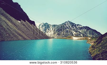 Lake In Alps With Mountains On Background, Toned Photo. Landscape In Summer Morning.