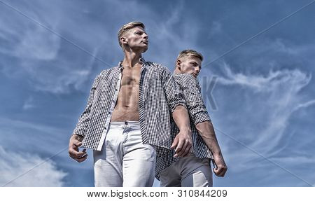Menswear And Fashion Concept. Brothers Twins Looks Attractive. Men Strong Athlete Wear Same Shirts.