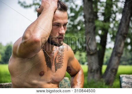 Muscular Shirtless Hunk Man Outdoor In City Park
