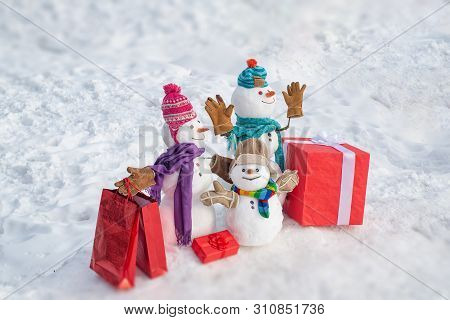 Delivery Gifts. Snowman With Gift In Christmas Day. Snowman With A Bag Of Gifts. Family Snowman On T
