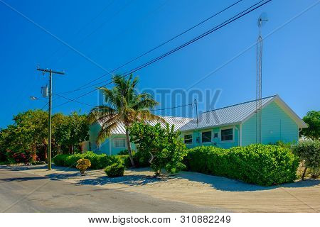 Little Cayman, Cayman Islands, Nov 2018, Blue Caribbean-style Houses With Tin Roof By Guy Banks Road