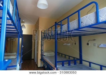Hostel Dormitory Beds Arranged In Dorm Room With White Plain Bunk Bed In Dormitory.hotel Dormitory H