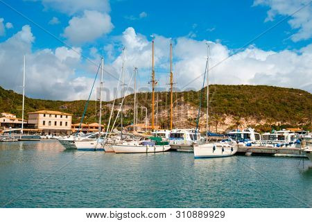 BONIFACIO, FRANCE - SEPTEMBER 19, 2018: A view over the port of Bonifacio, in Corse, France, with many yachts moored in the piers