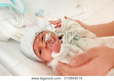 Close Up Of An Infant With Nose Feeding Tube, Icu
