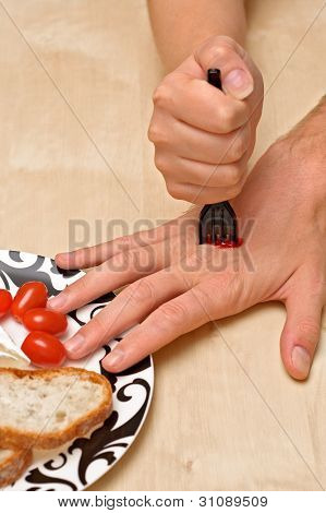 Stabbed hand with a fork
