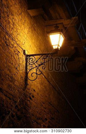 Old Vintage Street Lantern On A Brick Wall, Night Background, Victorian Vintage Style