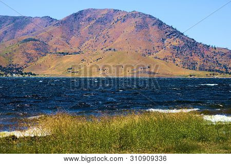 Lake With Whitecaps On A Windy Day Surrounded By Barren Mountains Taken In Lake Isabella, Ca