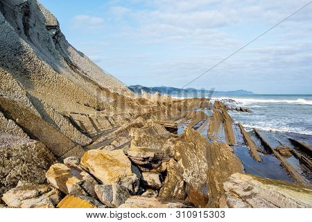 The Acantilado Flysch In Zumaia - Basque Country. Flysch Is A Sequence Of Sedimentary Rock Layers Th