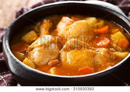 Fresh Homemade Chicken Stew With Potato, Carrot And Celery, Seasoned With Paprika In Rustic Bowl (se