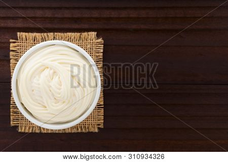Mayonnaise Sauce In White Bowl, Photographed Overhead With Copy Space On The Side (selective Focus,